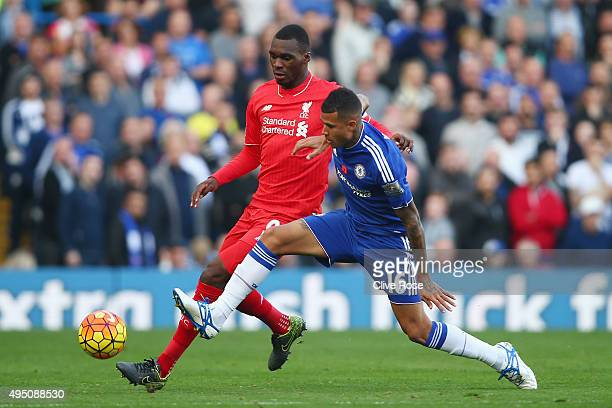 Kenedy of Chelsea and Christian Benteke of Liverpool compete for the ball during the Barclays Premier League match between Chelsea and Liverpool at...