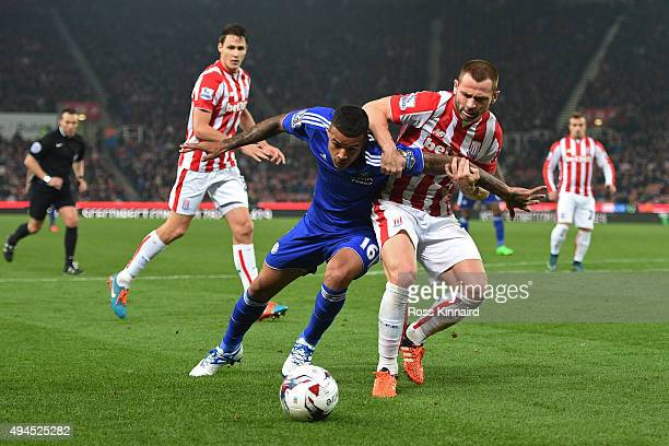 Kenedy of Chelsea and Phillip Bardsley of Stoke City battle for posession during the Capital One Cup fourth round match between Stoke City and...