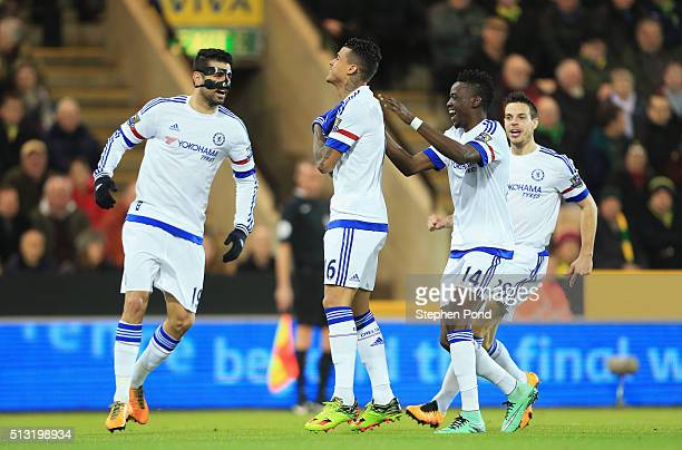 Kenedy of Chelsea celebrates scoring his team's first goal with his team mates during the Barclays Premier League match between Norwich City and...