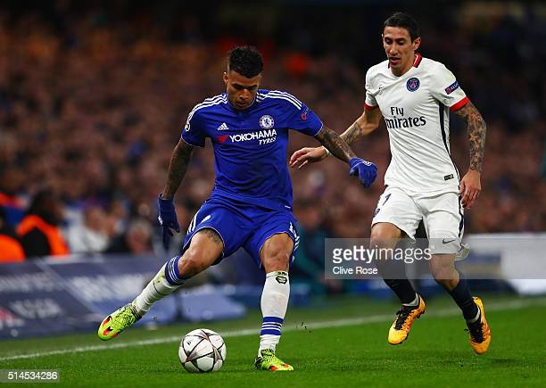 Kenedy of Chelsea passes the ball as Angel Di Maria of PSG closes in during the UEFA Champions League round of 16 second leg match between Chelsea...