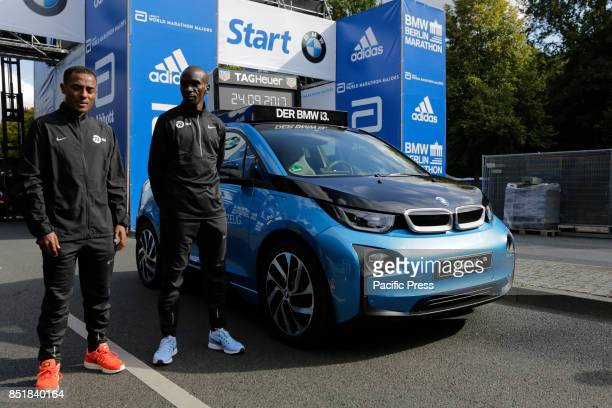 Kenenisa Bekele from Ethiopia and Eliud Kipchoge from Kenya pose for the cameras at the starting line The leading male and female runners for the...