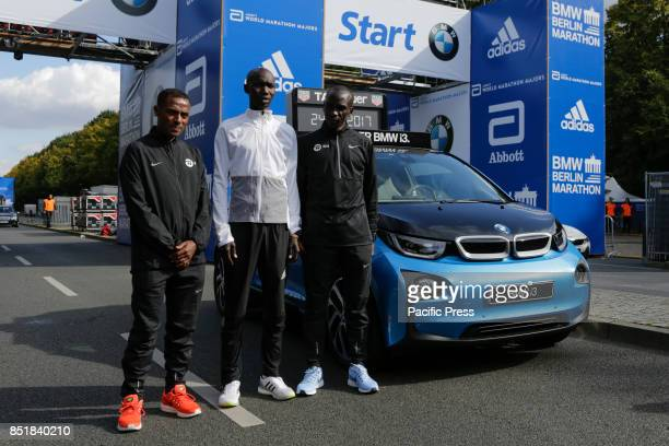 Kenenisa Bekele from Ethiopia Eliud Kipchoge from Kenya and Wilson Kipsang from Kenya pose for the cameras at the starting line The leading male and...
