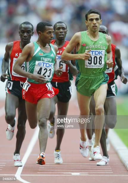 Kenenisa Bekele of Ethiopia and Hicham El Guerrouj of Morocco in action during the men's 5000m final at the 9th IAAF World Athletics Championships at...