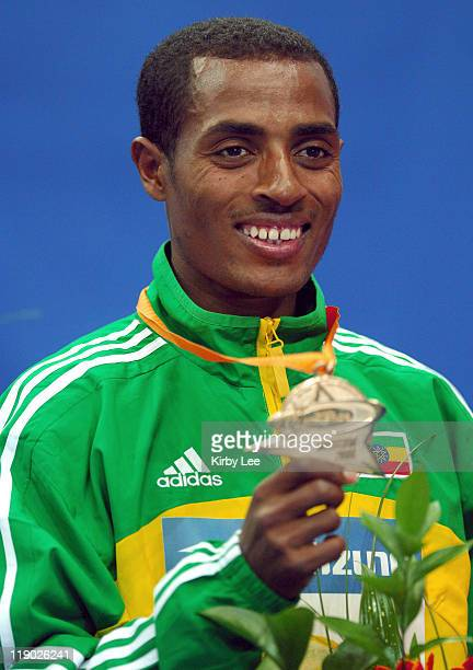 Kenenisa Bekele of Ethiopia poses with gold medal after winning the 3000 meters in 73932 in the IAAF World Indoor Championships in Athletics at the...