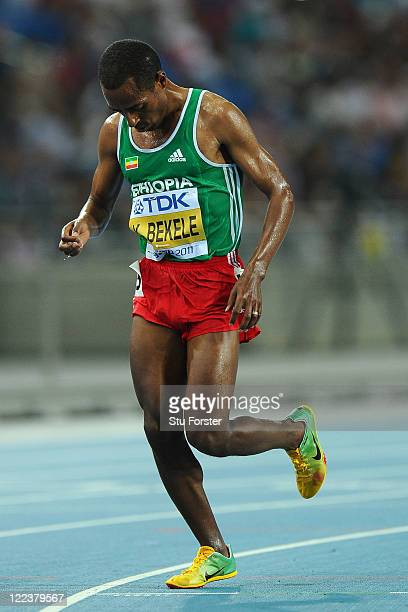 Kenenisa Bekele of Ethiopia withdraws from the men's 10000 metres final during day two of the 13th IAAF World Athletics Championships at the Daegu...