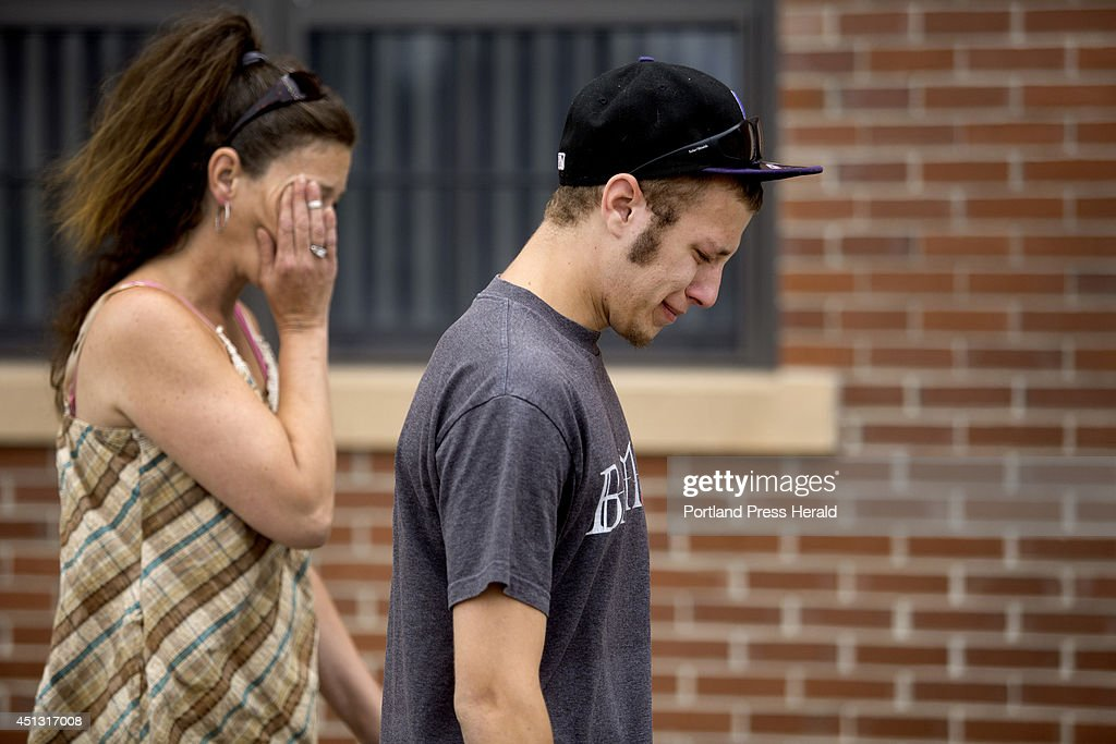 Kenesa Rivers, left, and her son, Chris Cote, 19, of Dover, N.H., fight back the tears as they leave the 7th district court in Dover Thursday, June 26, 2014, after Zachary Pinette, 18, of Springvale, Michael Tatum, 21, of Barrington, N.H., and Tristan Wolusky, 18, of Rochester, N.H., were arraigned on charges of first degree murder for causing the death of Aaron Wilkinson, 18, of Madbury, N.H. Cote was good friends with Wilkinson, whose body was found in Lebanon, Maine.