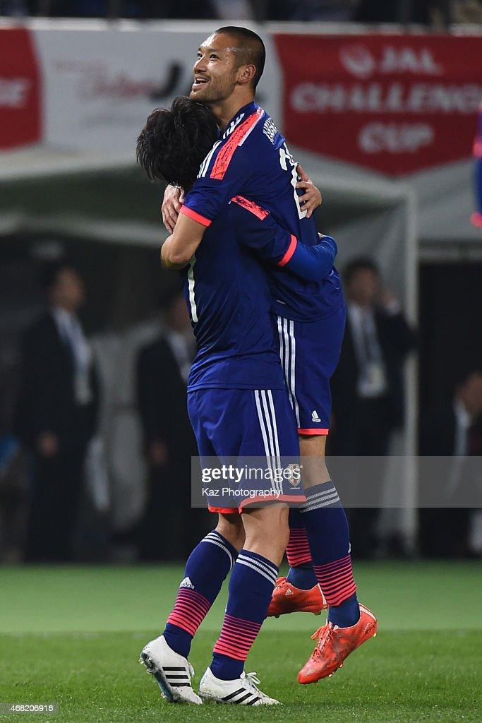 Kengo Kawamata of Japan celebrates Japan's 5th goal with Gaku Shibasaki of Japan during the international friendly match between Japan and Uzbekistan at Ajinomoto Stadium on March 31, 2015 in Tokyo, Japan.