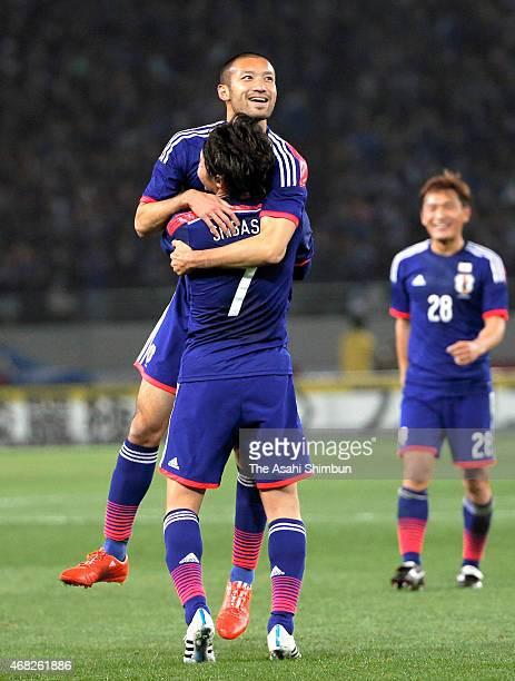 Kengo Kawamata of Japan celebrates scoring his team's fifth goal with his team mate Gaku Shibasaki during the international friendly match between...