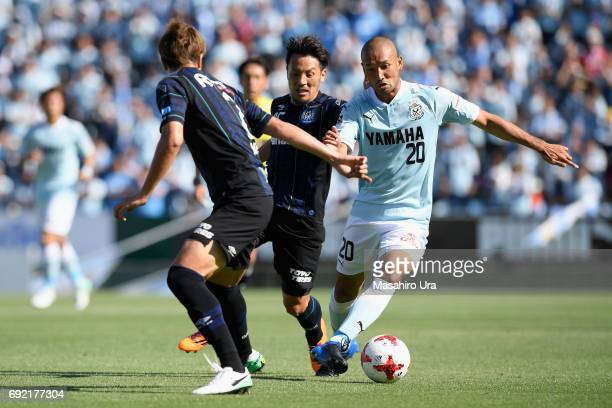 Kengo Kawamata of Jubilo Iwata and Jungo Fujimoto of Gamba Osaka compete for the ball during the JLeague J1 match between Jubilo Iwata and Gamba...