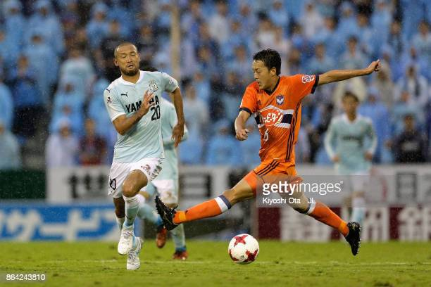 Kengo Kawamata of Jubilo Iwata and Ryota Isomura of Albirex Niigata compete for the ball during the JLeague J1 match between Jubilo Iwata and Albirex...