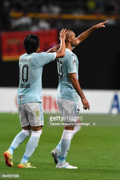 Kengo Kawamata of Jubilo Iwata celebrates scoring the opening goal with his team mate Shunsuke Nakamura during the JLeague J1 match between Consadole...