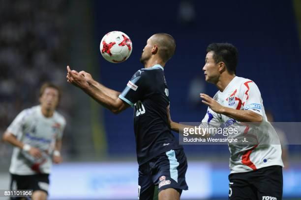 Kengo Kawamata of Jubilo Iwata controls the ball under pressure of Yasuyuki Konno of Gamba Osaka during the JLeague J1 match between Gamba Osaka and...