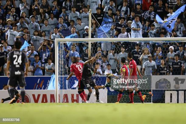 Kengo Kawamata of Jubilo Iwata scores his side's first goal with his team mates during the JLeague J1 match between Jubilo Iwata and Cerezo Osaka at...