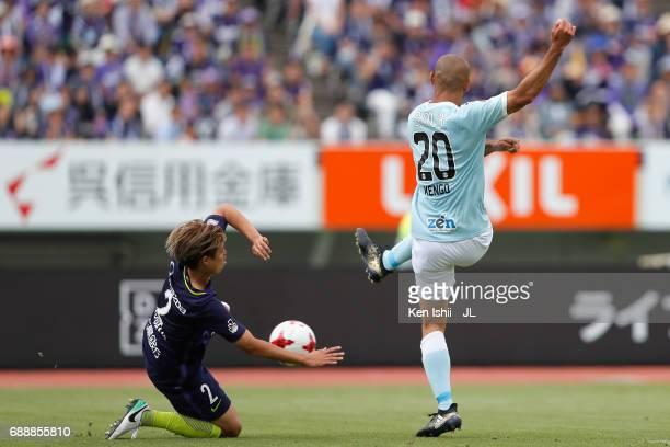 Kengo Kawamata of Jubilo Iwata shoots at goal while Yuki Nogami of Sanfrecce Hiroshima tries to block it during the JLeague J1 match between...