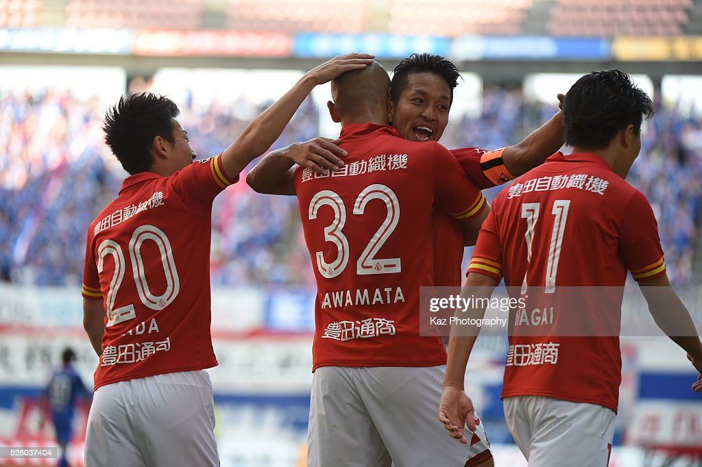 Kengo Kawamata of Nagoya Grampus celebrates the 3rd goal with Taishi Taguchi of Nagoya Grampus during the J.League match between Nagoya Grampus and Yokohama F.Marinos at the Toyota Stadium on May 4, 2016 in Toyota, Aichi, Japan.