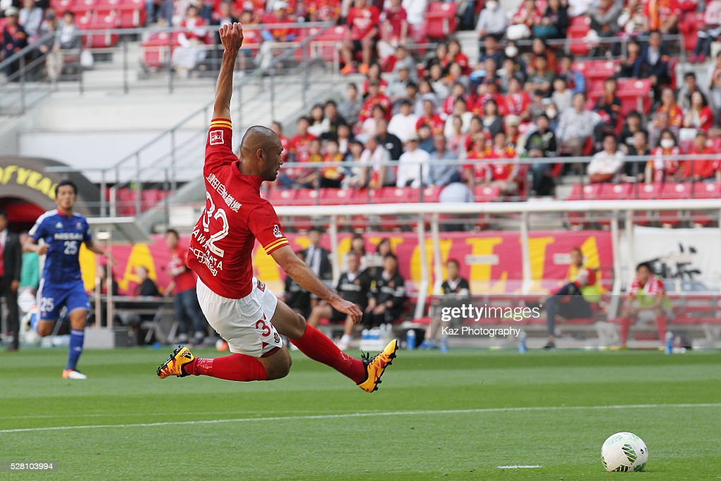 <a gi-track='captionPersonalityLinkClicked' href=/galleries/search?phrase=Kengo+Kawamata&family=editorial&specificpeople=8535845 ng-click='$event.stopPropagation()'>Kengo Kawamata</a> of nagoya Grampus scores his team's third goal during the J.League match between Nagoya Grampus and Yokohama F.Marinos at the Toyota Stadium on May 4, 2016 in Toyota, Aichi, Japan.