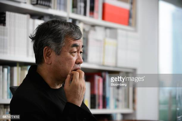 Kengo Kuma Japanese architect pauses during an interview in Tokyo Japan on Friday May 12 2017 Using Japanese lumber for the centerpiece...