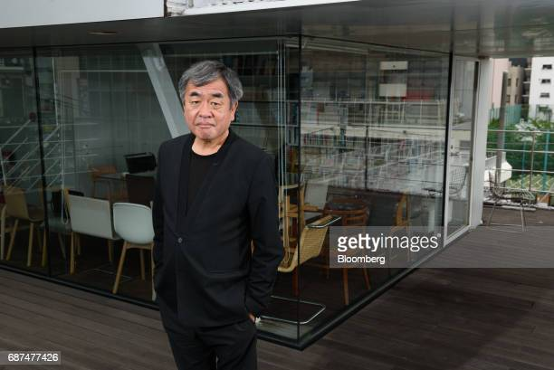 Kengo Kuma Japanese architect poses for a photograph in Tokyo Japan on Friday May 12 2017 Using Japanese lumber for the centerpiece venueKumawants...