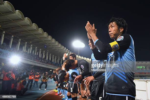 Kengo Nakamura and players of Kawasaki Frontale react after losing the AFC Champions League Round of 16 match between Kawasaki Frontale and FC Seoul...
