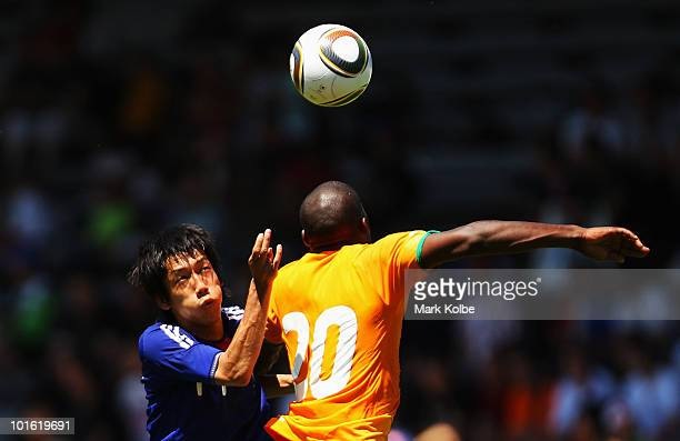 Kengo Nakamura of Japan and GuyRoland Demel 0f Ivory Coast compete for the ball during the Japan v Ivory Coast International Friendly match at Stade...