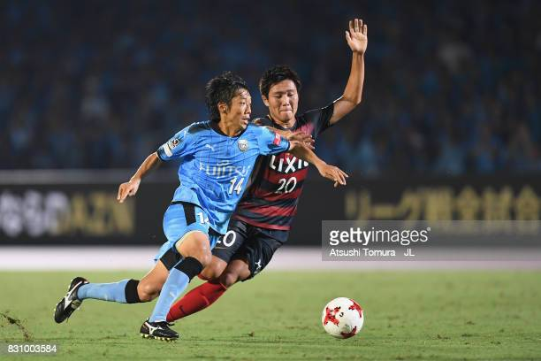 Kengo Nakamura of Kawasaki Frontale and Kento Misao of Kashima Antlers compete the ball during the JLeague J1 match between Kawasaki Frontale and...
