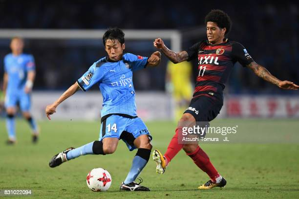 Kengo Nakamura of Kawasaki Frontale and Leandro of Kashima Antlers compete for the ball during the JLeague J1 match between Kawasaki Frontale and...