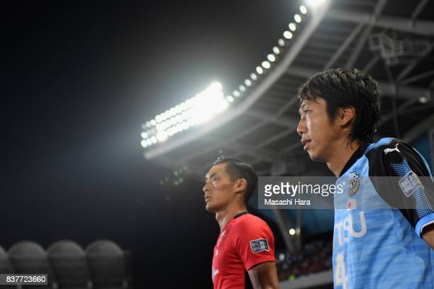Kengo Nakamura of Kawasaki Frontale and Tomoaki Makino of Urawa Red Diamonds enter the pitch prior to the AFC Champions League quarter final first...
