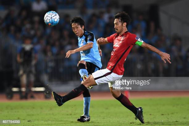 Kengo Nakamura of Kawasaki Frontale and Yuki Abe of Urawa Red Diamonds compete for the ball during the AFC Champions League quarter final first leg...