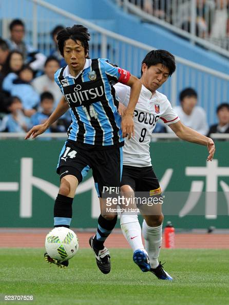 Kengo Nakamura of Kawasaki Frontale and Yuki Muto of Urawa Red Diamonds compete for the ball during the JLeague match between Kawasaki Frontale and...