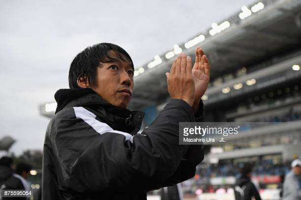 Kengo Nakamura of Kawasaki Frontale applauds supporters after his side's 10 victory in the JLeague J1 match between Kawasaki Frontale and Gamba Osaka...