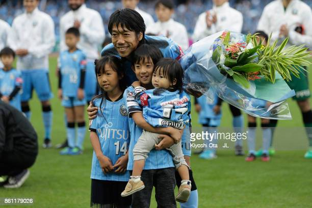 Kengo Nakamura of Kawasaki Frontale attends the ceremony marking his 400th appearance in the J1 with his children prior to the JLeague J1 match...