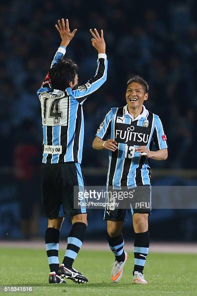 Kengo Nakamura of Kawasaki Frontale celebrates scoring his team's third goal with his team mate Yoshito Okubo during the JLeague match between...