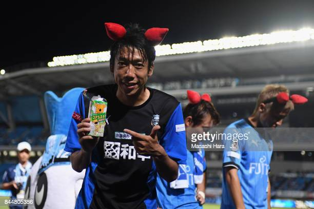 Kengo Nakamura of Kawasaki Frontale cerebrates to have the koalas' march in his hand after their 03 victory in the JLeague J1 match between Kawasaki...