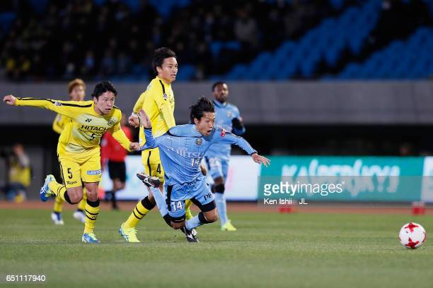Kengo Nakamura of Kawasaki Frontale is fouled by Yuta Nakayama of Kashiwa Reysol resulting in a red card to Nakayama during the JLeague J1 match...