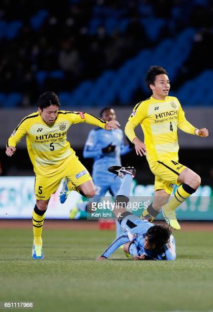 Kengo Nakamura of Kawasaki Frontale is fouled by Yuta Nakayama of Kashiwa Reysol resulting in a red card to Nakayama during the JLeague J1 match...