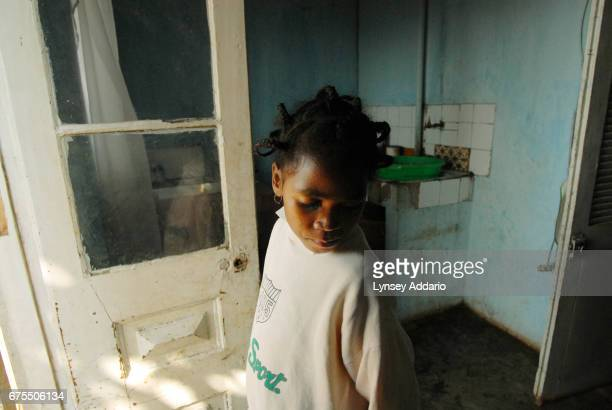 Kenia Moravelo stands by the door in the shelter where she has been staying since released from her most recent stay in the hospital November 9 2006...