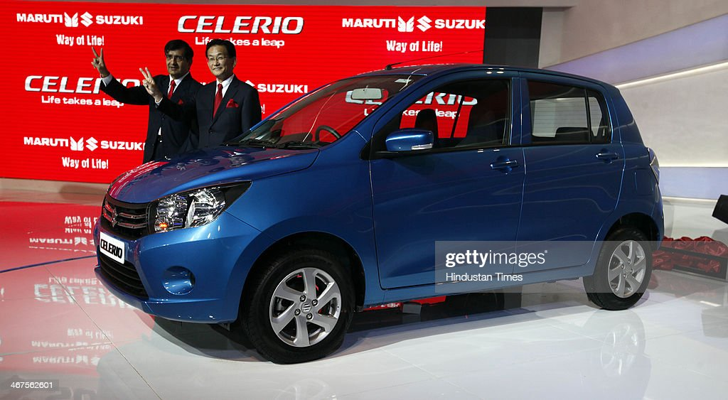 Kenichi Ayukawa, managing director and CEO of Maruti Suzuki India and Mayank Pareek, COO Maruti Suzuki unveiled the Celerio hatchback at the Auto Expo 2014 during 12th Auto Expo, at India Expo Mart on February 6, 2014 in Greater Noida, India.