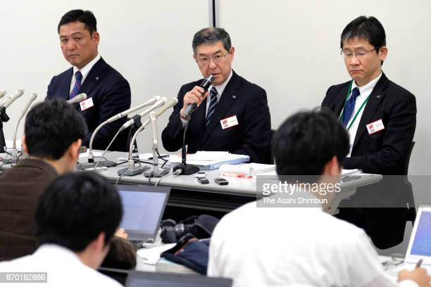 Kenichi Shibasaki senior managing executive officer and Tomoki Otani senior executive officer of Yamato Holdings Co attend a news conference on April...