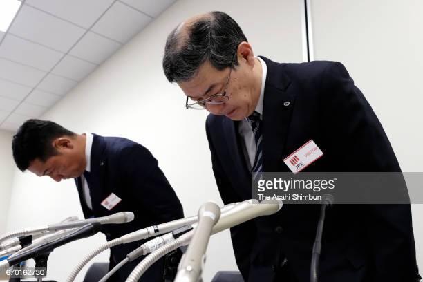 Kenichi Shibasaki senior managing executive officer and Tomoki Otani senior executive officer of Yamato Holdings Co bow during a news conference on...