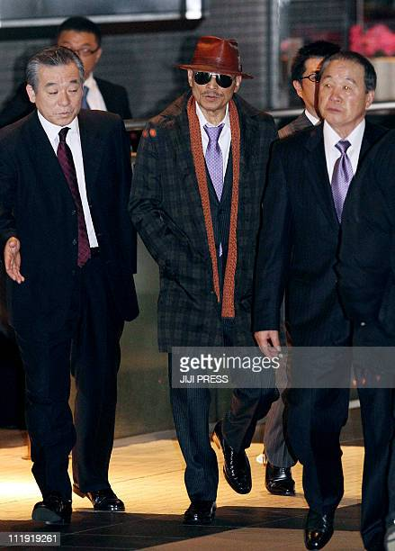 Kenichi Shinoda the boss of Japan's largest 'yakuza' gang the Yamaguchigumi walks at Tokyo's Shinagawa station to return to his his home in Kobe...