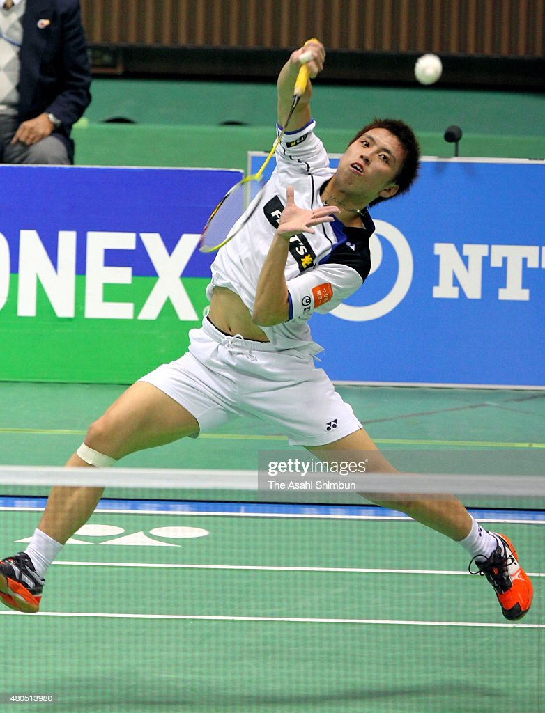 <a gi-track='captionPersonalityLinkClicked' href=/galleries/search?phrase=Kenichi+Tago&family=editorial&specificpeople=5533307 ng-click='$event.stopPropagation()'>Kenichi Tago</a> competes in the Men's Singles final against Sho Sasaki during day six of the All Japan Badminton Championships at Yoyogi National Gymnasium on December 11, 2011 in Tokyo, Japan.