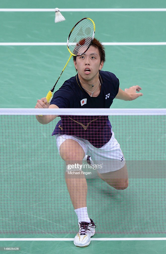 <a gi-track='captionPersonalityLinkClicked' href=/galleries/search?phrase=Kenichi+Tago&family=editorial&specificpeople=5533307 ng-click='$event.stopPropagation()'>Kenichi Tago</a> of Japan competes against Niluka Karunaratne of Sri Lanka during his Men's Singles Badminton match on Day 3 of the London 2012 Olympic Games at Wembley Arena on July 30, 2012 in London, England.