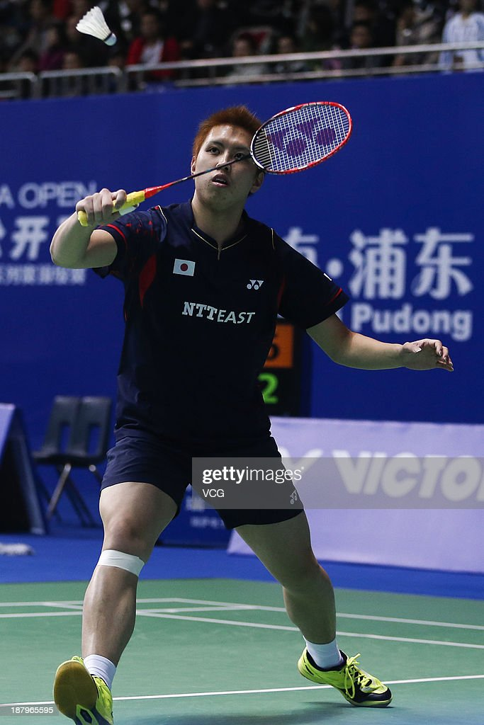 <a gi-track='captionPersonalityLinkClicked' href=/galleries/search?phrase=Kenichi+Tago&family=editorial&specificpeople=5533307 ng-click='$event.stopPropagation()'>Kenichi Tago</a> of Japan competes against Sony Dwi Kuncoro of Indonesia during the men's singles match on day three of China Open 2013 at Yuanshen Gymnasium on November 14, 2013 in Shanghai, China.