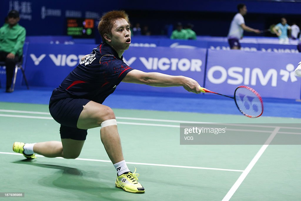 <a gi-track='captionPersonalityLinkClicked' href=/galleries/search?phrase=Kenichi+Tago&family=editorial&specificpeople=5533307 ng-click='$event.stopPropagation()'>Kenichi Tago</a> of Japan competes against Xue Song of China during the men's singles match on day two of China Open 2013 at Yuanshen Gymnasium on November 13, 2013 in Shanghai, China.