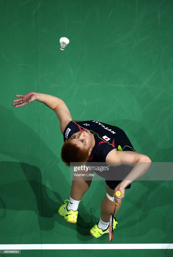 <a gi-track='captionPersonalityLinkClicked' href=/galleries/search?phrase=Kenichi+Tago&family=editorial&specificpeople=5533307 ng-click='$event.stopPropagation()'>Kenichi Tago</a> of Japan in action against Chen Long of China during the Men's Singles match on day one of the BWF Destination Dubai World Superseries Finals at the Hamdan Sports Complex on December 17, 2014 in Dubai, United Arab Emirates.