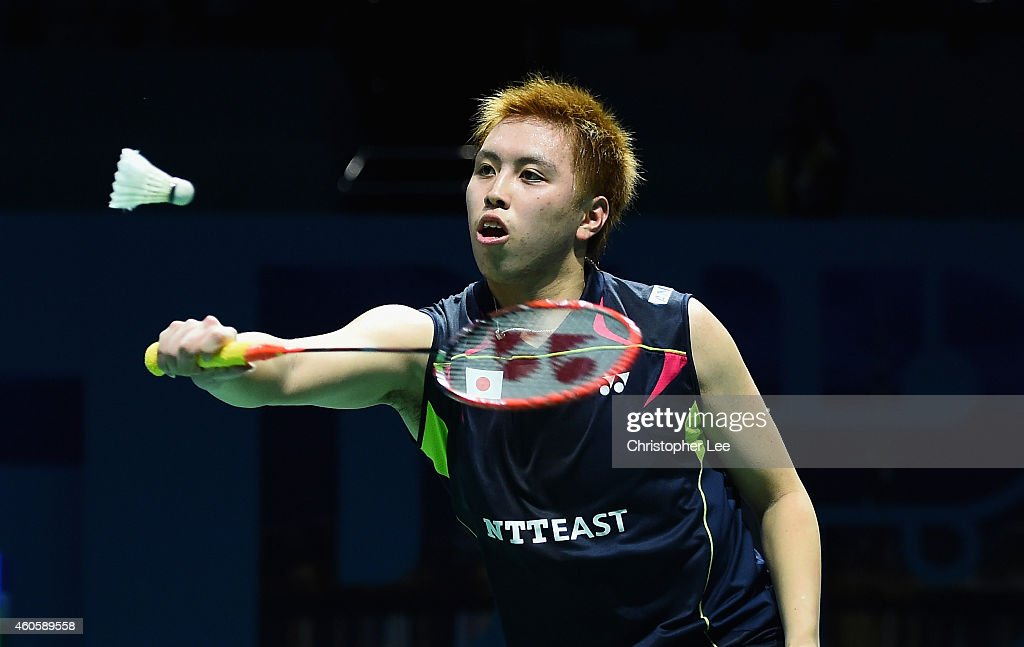 <a gi-track='captionPersonalityLinkClicked' href=/galleries/search?phrase=Kenichi+Tago&family=editorial&specificpeople=5533307 ng-click='$event.stopPropagation()'>Kenichi Tago</a> of Japan in action against Chen Long of China in the Mens Singles during day one of the BWF Destination Dubai World Superseries Finals at the Hamdan Sports Complex on December 17, 2014 in Dubai, United Arab Emirates.