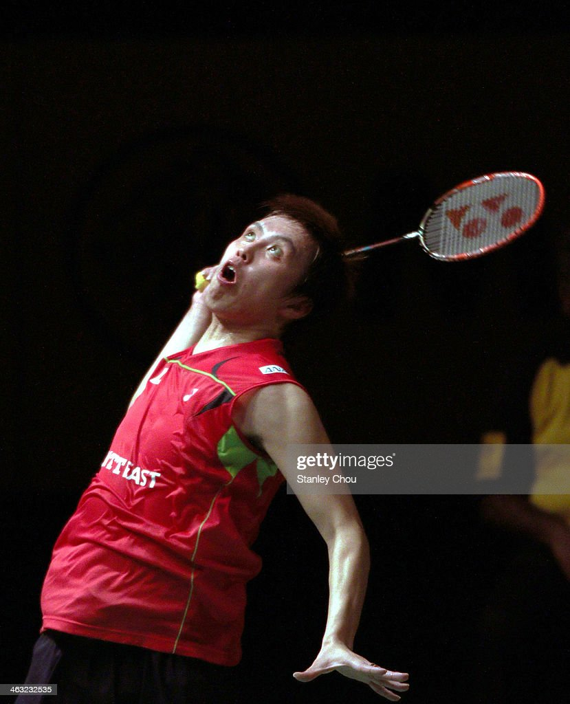 <a gi-track='captionPersonalityLinkClicked' href=/galleries/search?phrase=Kenichi+Tago&family=editorial&specificpeople=5533307 ng-click='$event.stopPropagation()'>Kenichi Tago</a> of Japan plays a shot to Chen Long of China during day four of the Men's Singles of the Malaysia Badminton Open on January 17, 2014 in Kuala Lumpur, Malaysia.