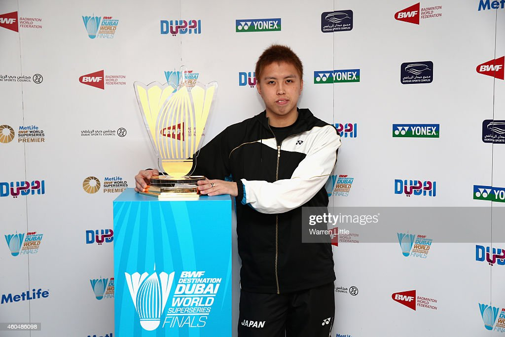 <a gi-track='captionPersonalityLinkClicked' href=/galleries/search?phrase=Kenichi+Tago&family=editorial&specificpeople=5533307 ng-click='$event.stopPropagation()'>Kenichi Tago</a> of Japan poses with the trophy after the draw ceremony and press conference for the BWF Destination Dubai World Superseries Finals at the InterContinental Hotel on December 15, 2014 in Dubai, United Arab Emirates.