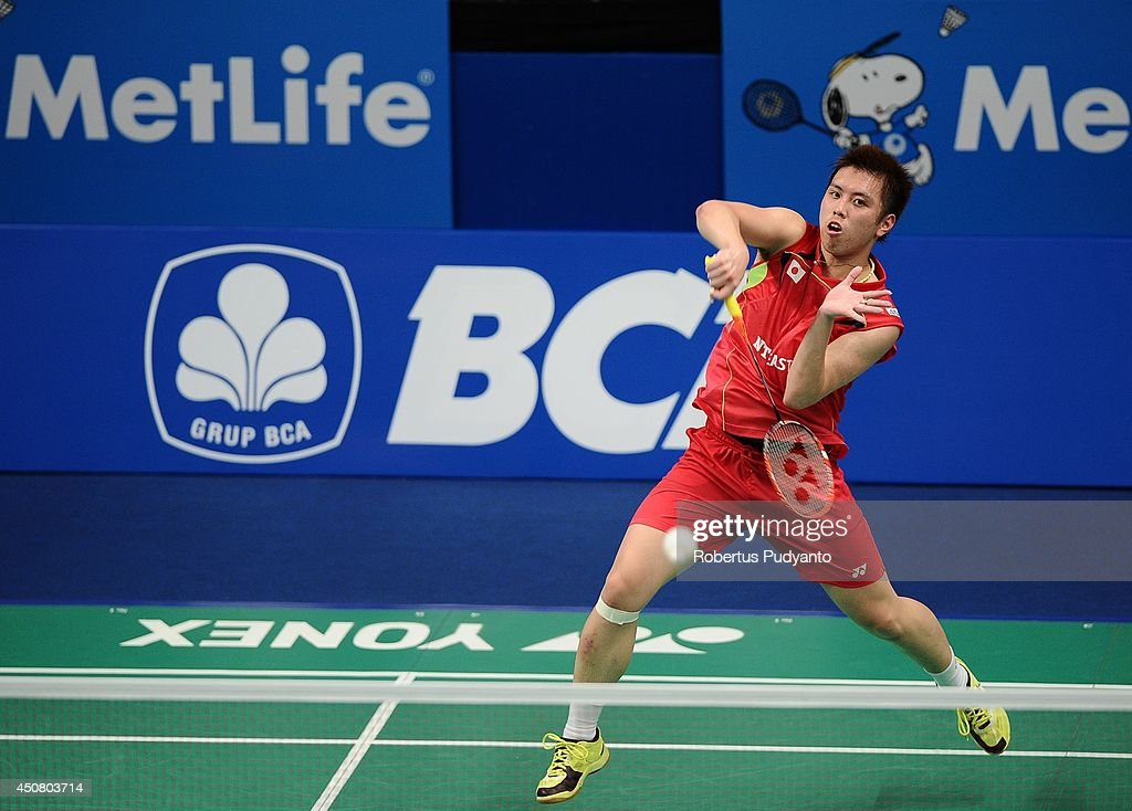 <a gi-track='captionPersonalityLinkClicked' href=/galleries/search?phrase=Kenichi+Tago&family=editorial&specificpeople=5533307 ng-click='$event.stopPropagation()'>Kenichi Tago</a> of Japan returns a shot against Parupalli Kashyap of India during the BCA Indonesia Open 2014 MetLife BWF World Super Series Premier at Istora Gelora Bung Karno Stadium on June 18, 2014 in Jakarta, Indonesia.