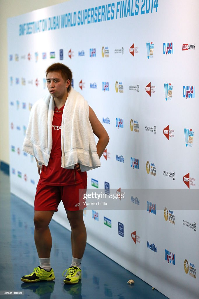 <a gi-track='captionPersonalityLinkClicked' href=/galleries/search?phrase=Kenichi+Tago&family=editorial&specificpeople=5533307 ng-click='$event.stopPropagation()'>Kenichi Tago</a> of Japan speaks with the media after winning his match after Son Wan Ho of Korea forfeited the match duw to injury during day two of the BWF Destination Dubai World Superseries Finals at the Hamdan Sports Complex on December 18, 2014 in Dubai, United Arab Emirates.